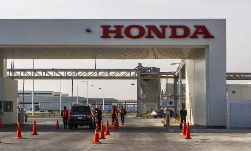 <p>View of the main entrance to a new Honda manufacturing plant in Celaya, on February 21, 2014, in Guanajuato state, Mexico</p>
