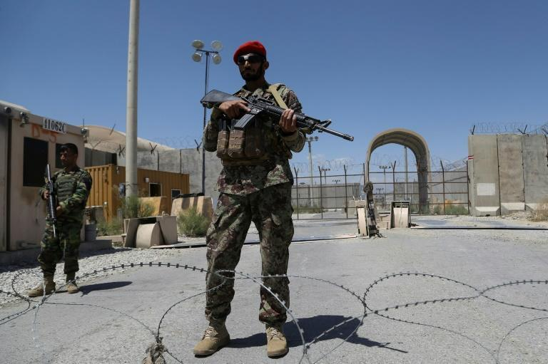 An Afghan National Army (ANA) soldier stands guard at Bagram Air Base, after all US and NATO troops left, on July 2, 2021