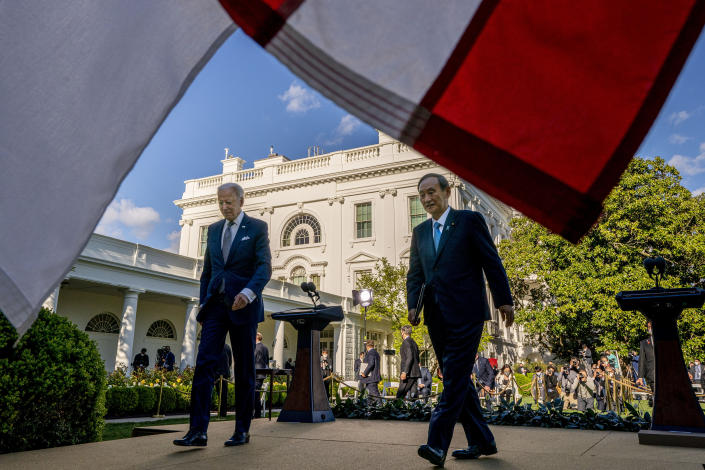 President Joe Biden and Japanese Prime Minister Yoshihide Suga leave a news conference in the Rose Garden of the White House in Washington, Friday, April 16, 2021. (AP Photo/Andrew Harnik)