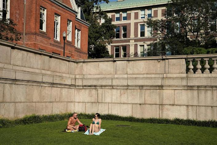 "<span class=""element-image__caption"">People are seated on the grass a Columbia University during in New York City on 23 August.</span> <span class=""element-image__credit"">Photograph: John Lamparski/Getty Images</span>"