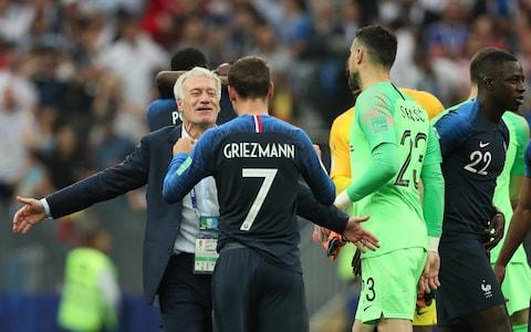 A delighted Didier Deschamps head coach / manager of France at full time with Antoine Griezmann - Credit: Getty Images