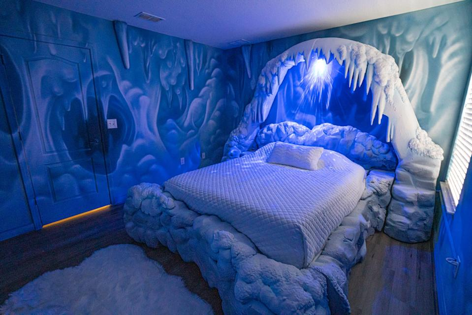 """The blue light gives the room a chilling look. <p class=""""copyright"""">Loma Homes</p>"""