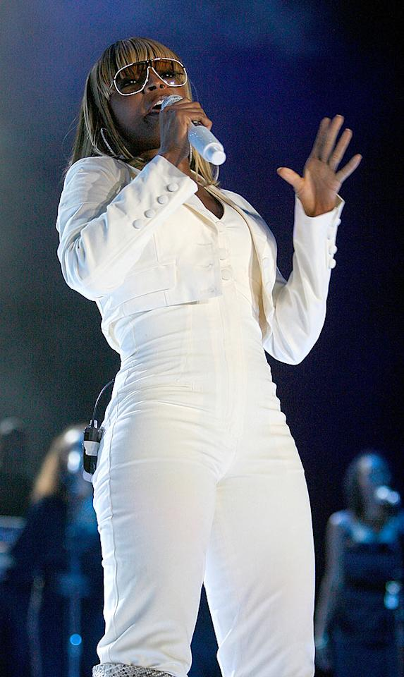 "Queen of Hip Hop Soul Mary J. Blige wails while wearing a white jumpsuit and a cute cropped blazer. Sean Gardner/<a href=""http://www.gettyimages.com/"" target=""new"">GettyImages.com</a> - July 6, 2008"