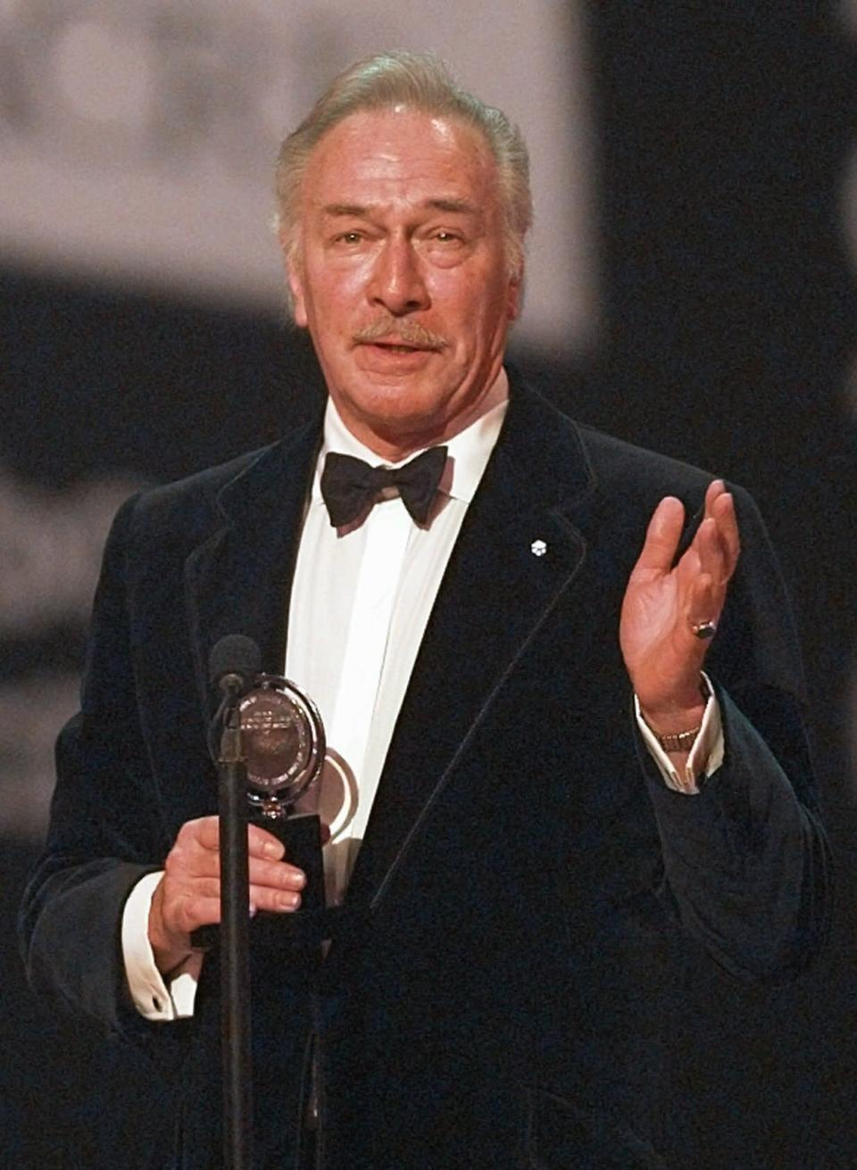 "FILE - Christopher Plummer accepts his award for best leading actor in a play for his role in ""Barrymore"" during the 51st Annual Tony Awards on June 1, 1997, in New York. Plummer, the dashing award-winning actor who played Captain von Trapp in the film ""The Sound of Music"" and at 82 became the oldest Academy Award winner in history, has died. He was 91. Plummer died Friday morning, Feb. 5, 2021, at his home in Connecticut with his wife, Elaine Taylor, by his side, said Lou Pitt, his longtime friend and manager. (AP Photo/Adam Nadel, File)"