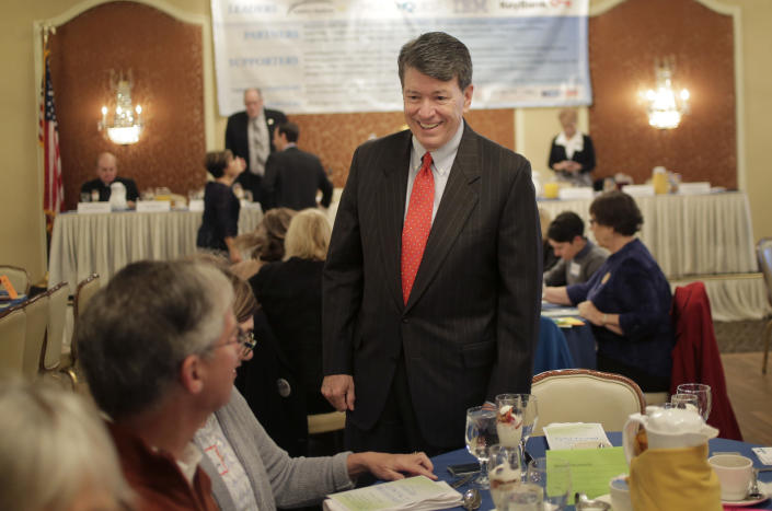 Republican U.S. Rep. John Faso speaks to people before the start of a candidate forum in Poughkeepsie, N.Y., Wednesday, Oct. 17, 2018. The race in the 19th Congressional District pits Faso against Democrat Antonio Delgado, a rapper-turned-corporate lawyer seeking his first political office.(AP Photo/Seth Wenig)