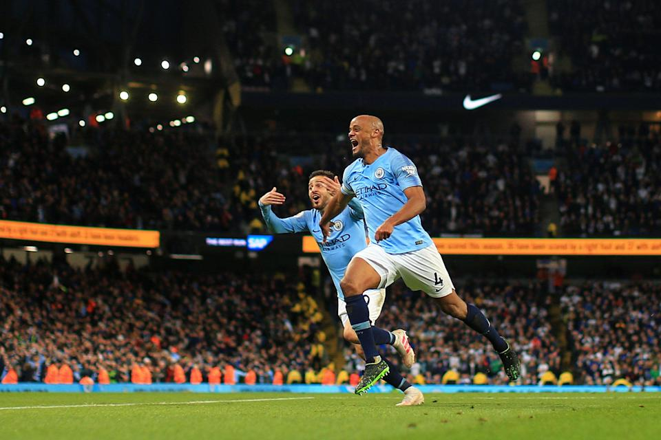 MANCHESTER, ENGLAND - MAY 06: Vincent Kompany of Manchester City celebrates after scoring his team's first goal with Bernardo Silva of Manchester City during the Premier League match between Manchester City and Leicester City at Etihad Stadium on May 06, 2019 in Manchester, United Kingdom. (Photo by Tom Flathers/Man City via Getty Images)