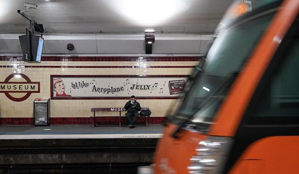 A lone passenger waits on a train platform in Sydney, which has been put in lockdown to curb the spread of Covid-19. Photo: Reuters
