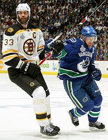 After a seven-game battle in last June's Stanley Cup final, Zdeno Chara's Bruins and Henrik Sedin's Canucks have struggled in the early stages of 2011-12