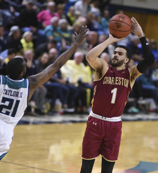 College of Charleston guard Grant Riller shoots over UNC Wilmington guard Ty Taylor during an NCAA college basketball game in Wilmington, N.C., Saturday, Feb. 17, 2018. (Matt Born/The Star-News via AP)