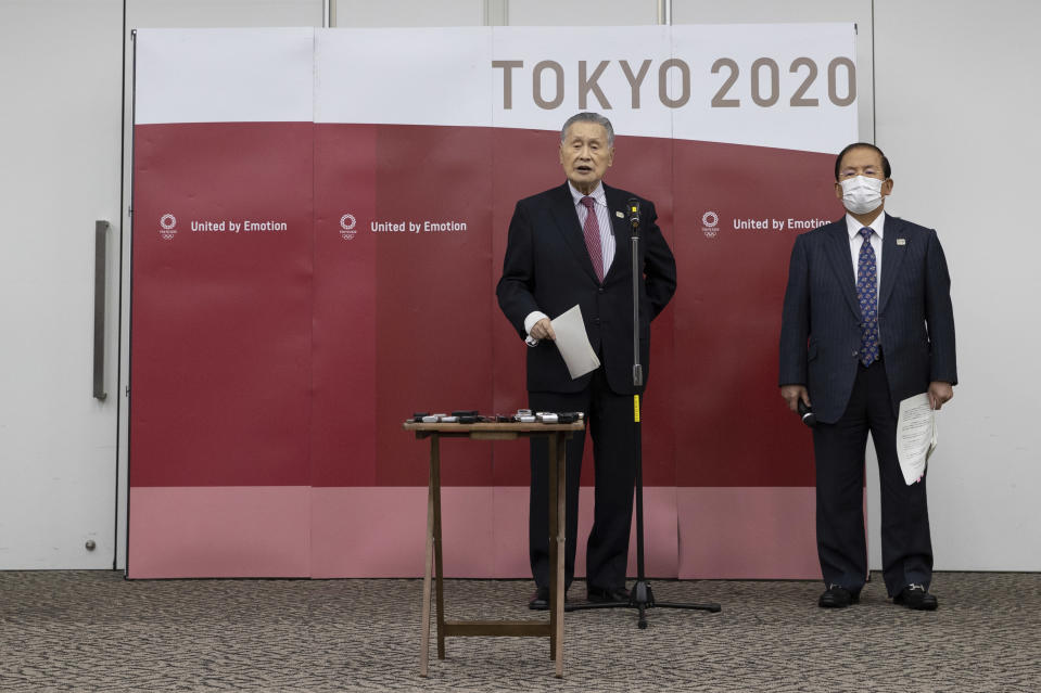 Tokyo Olympic and Paralympic Games Organising Committee (TOGOC) President Yoshiro Mori, left, and CEO Toshiro Muto speak to the media after their video conference with IOC President Thomas Bach at the TOGOC headquarters in Tokyo Thursday, Jan. 28, 2021. The IOC and organizers in Japan repeatedly insisted on Wednesday there is no Plan B for the Tokyo Games, which were already postponed by one year during the coronavirus pandemic. (Takashi Aoyama/Pool Photo via AP)