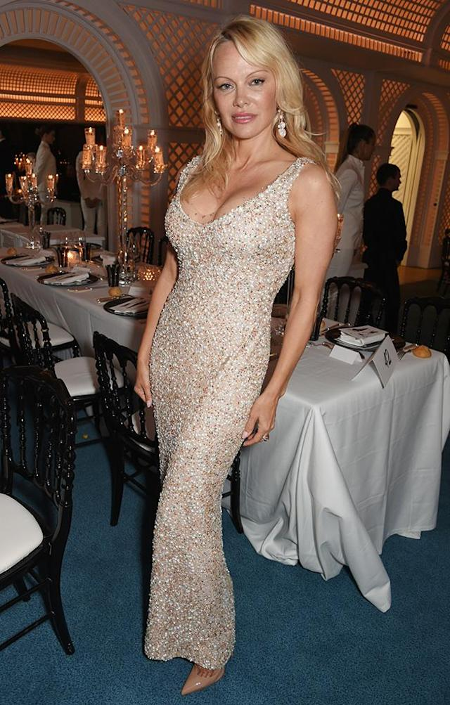 <p>Pamela Anderson took a break from whatever she's doing with Julian Assange to party in Cannes. The one-time Playmate, who makes a cameo in the <em>Baywatch</em> movie (which is definitely <em>not</em> part of the Cannes program), hit up the Love on the Rocks bash on May 23, but mostly had people talking about how different her face looks these days. (Photo: David M Benett/Dave Benett/Getty Images ) </p>