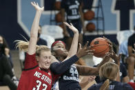 North Carolina State center Elissa Cunane (33) and North Carolina center Janelle Bailey (44) struggle for possession of the ball during the second half of an NCAA college basketball game in Chapel Hill, N.C., Sunday, Feb. 7, 2021. (AP Photo/Gerry Broome)
