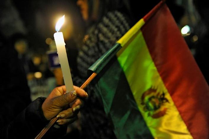 Vigils in Bolivia commemorate the victims of clashes between opposing groups in the country's disputed election (AFP Photo/JORGE BERNAL)