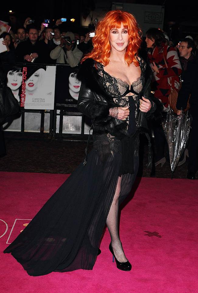 """In addition to bombing at the box office, the stars of """"Burlesque"""" have been bombing at nearly every red carpet premiere. At the film's London debut, Cher dared to don this lacy Julien Macdonald mess, along with a fur-trimmed leather jacket and bright orange wig. Mike Marsland/<a href=""""http://www.wireimage.com"""" target=""""new"""">WireImage.com</a> - December 13, 2010"""