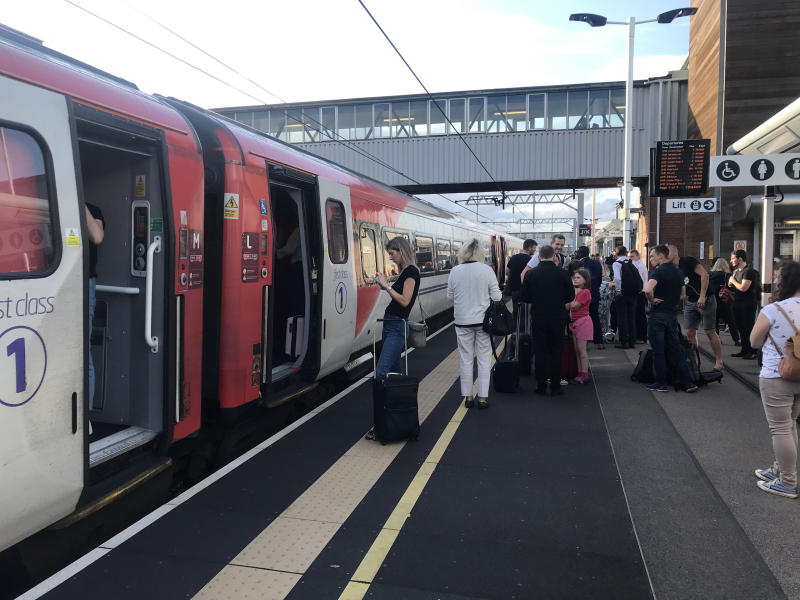 Passengers wait for news at Peterborough station during travel disruption on the East Coast mainline, after a large power cut has caused �apocalyptic� rush-hour scenes across England and Wales, with traffic lights down and trains coming to a standstill.