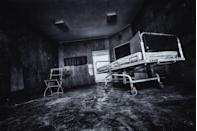 """<p>Let's face it. There's a reason why hospitals are the primary setting for so many of our favorite horror movies: they're just plain creepy. But when hospitals and mental institutions are completely abandoned for one reason or another and are just left to decay, the spook factor multiplies ten-fold. There are plenty <a href=""""https://www.redbookmag.com/life/g29002375/spookiest-abandoned-places-in-every-state/"""" rel=""""nofollow noopener"""" target=""""_blank"""" data-ylk=""""slk:spooky abandoned buildings"""" class=""""link rapid-noclick-resp"""">spooky abandoned buildings</a> all over the world, but between the large empty corridors, forgotten medical equipment, and, um, morgues that are just a little <em>too </em>quiet, abandoned hospitals take the top spot as places you wouldn't want to be after dark. </p>"""