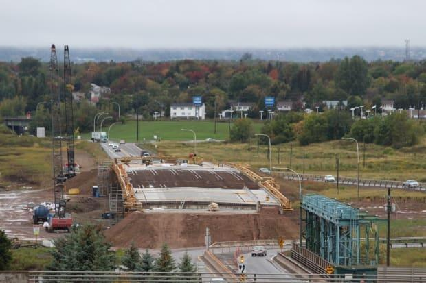 The new Petitcodiac River bridge will be opened to traffic when work is completed in October.