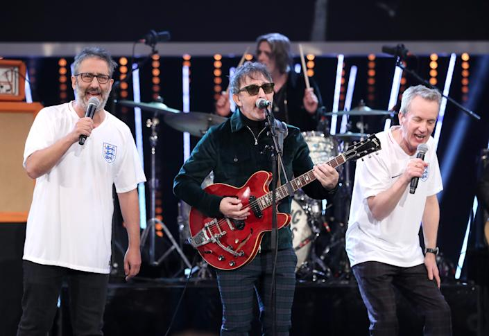 Ian Broudie (centre) of the Lightning Seeds performs with David Baddiel (left) and Frank Skinner during the BBC Sports Personality of the Year 2018 at Birmingham Genting Arena.