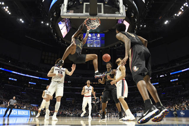 <p>Florida State Seminoles forward Phil Cofer #0 goes up for the dunk in front of Gonzaga Bulldogs guard Josh Perkins #13 during the third round of the 2018 NCAA Men's Basketball Tournament held at Staples Center on March 22, 2018 in Los Angeles, California. (Photo by Jamie Schwaberow/NCAA Photos via Getty Images) </p>