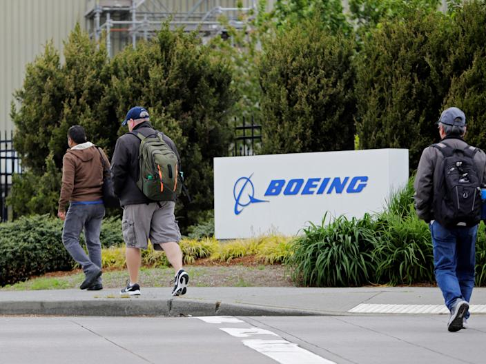 "Workers enter the Boeing factory in Renton, Washington on April 21, 2020, as commercial airplane production resumes following a suspension of operations in response to the coronavirus pandemic. <p class=""copyright"">Reuters</p>"