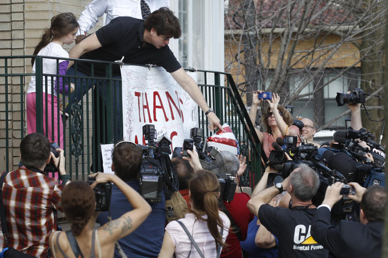 Former Illinois Gov. Rod Blagojevich reaches over to supporters outside of his home Wednesday, March 14, 2012 in Chicago. Blagojevich was convicted of 18 criminal counts over two trials, including charges that accused him of attempting to sell or trade an appointment to President Barack Obama's vacated U.S. The 55-year-old Democrat is due to report to a prison in Colorado on Thursday to begin serving a 14-year sentence, making him the second Illinois governor in a row to go to prison for corruption. At left is his daughter Annie. (AP Photo/M. Spencer Green)