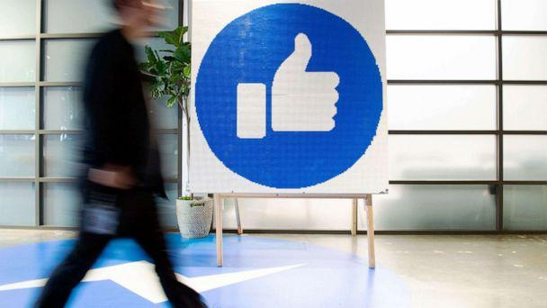 PHOTO: A Facebook employee walks by a sign displaying the 'like' sign at Facebook's corporate headquarters campus in Menlo Park, Calif., Oct. 23, 2019. (Josh Edelson/AFP via Getty Images, FILE)