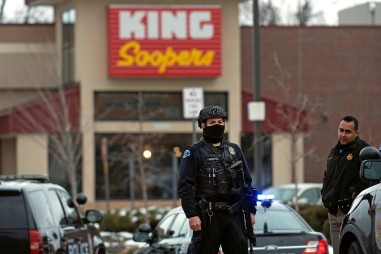Police officers secure the perimeter of the King Soopers grocery store in Boulder, Colorado -- scene of a deadly shooting