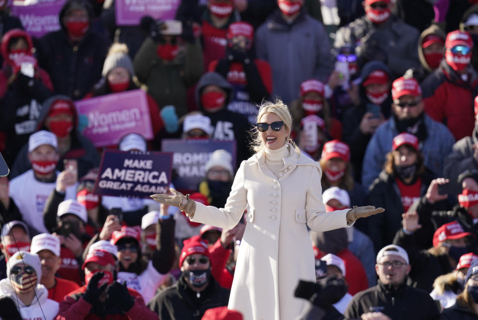 Ivanka Trump reacts on stage as President Donald Trump speaks at a campaign rally at Dubuque Regional Airport, Sunday, Nov. 1, 2020, in Dubuque, Iowa. (AP Photo/Charlie Neibergall)