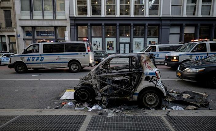A destroyed New York police car is seen after a night of protests over the death of African-American man George Floyd (AFP Photo/Johannes EISELE)