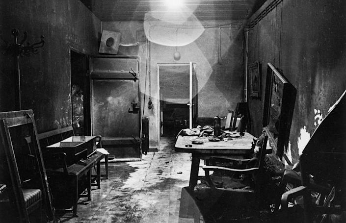 """This is a new view of a photograph that appeared, heavily cropped, in LIFE, picturing Hitler's command center in the Berlin bunker, partially burned by retreating German troops and stripped of valuables by invading Russians. (William Vandivert—Time & Life Pictures/Getty Images) <br> <br> <a href=""""http://life.time.com/history/inside-hitlers-bunker-rare-and-unpublished-photos/#1"""" rel=""""nofollow noopener"""" target=""""_blank"""" data-ylk=""""slk:Click here"""" class=""""link rapid-noclick-resp"""">Click here</a> to see the complete collection of pictures and read the full story at LIFE.com"""