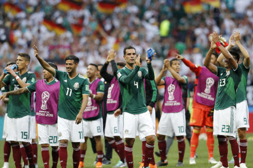 Mexico's Rafael Marquez, center and his teammates celebrate after winning the group F match between Germany and Mexico at the 2018 soccer World Cup in the Luzhniki Stadium in Moscow, Russia, Sunday, June 17, 2018. Mexico won Germany 1-0. (AP Photo/Antonio Calanni)
