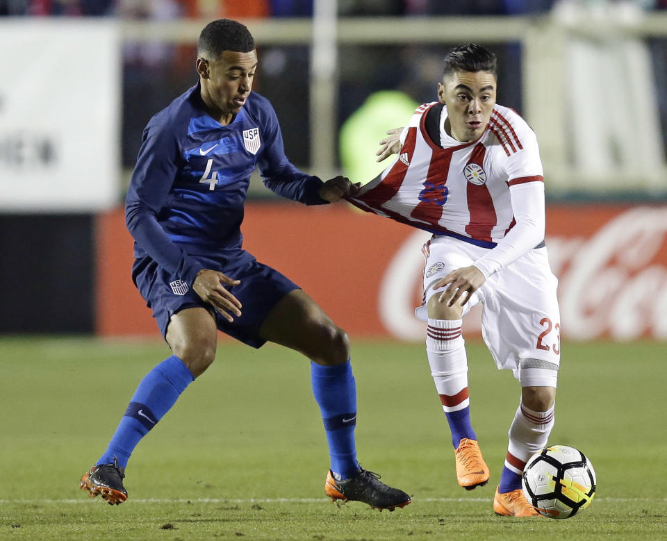 United States' Tyler Adams (4) and Paraguay's Miguel Almirón (23) chase the ball during the first half of an international friendly soccer match in Cary, N.C., Tuesday, March 27, 2018. (AP Photo/Gerry Broome)