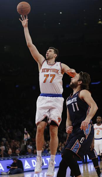 New York Knicks' Andrea Bargnani (77), of Italy, drives past Charlotte Bobcats' Josh McRoberts (11) during the first half of an NBA basketball game on Friday, Oct. 25, 2013, in New York. (AP Photo/Frank Franklin II)