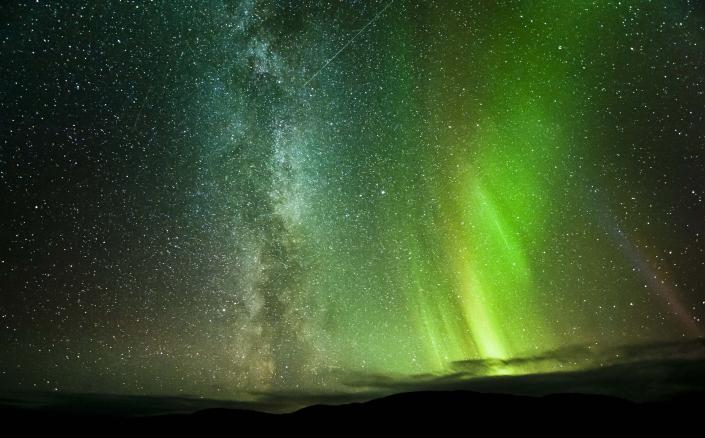 A rare photo captured the Northern Lights and Milky Way in the same image. It was snapped by an amateur photographer, who also points out a third visual surprise -- a meteor streaking across the sky. It was taken in Ifjord, Finmark, Norway. (Courtesy Caters News)