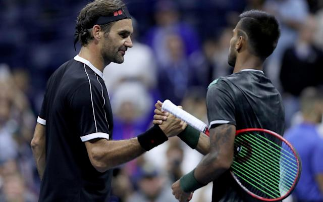 Roger Federer (left) dropped the first set of his US Open campaign to qualifier Sumit Nagal - Getty Images North America