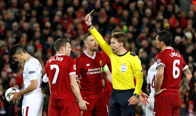 Soccer Football - Champions League Semi Final First Leg - Liverpool vs AS Roma - Anfield, Liverpool, Britain - April 24, 2018 Liverpool's James Milner is shown a yellow card by referee Felix Brych Action Images via Reuters/Carl Recine