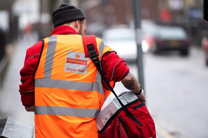 A postal worker delivers post on March 17, 2020 in Cardiff. (Photo: Polly Thomas via Getty Images)