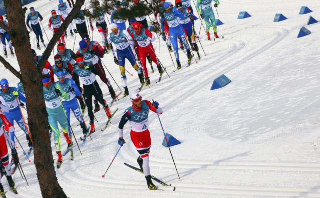 Cross-Country Skiing - Pyeongchang 2018 Winter Olympics - Men's 50km Mass Start Classic - Alpensia Cross-Country Skiing Centre - Pyeongchang, South Korea - February 24, 2018 - Martin Johnsrud Sundby of Norway in action ahead of the pack. REUTERS/Carlos Barria