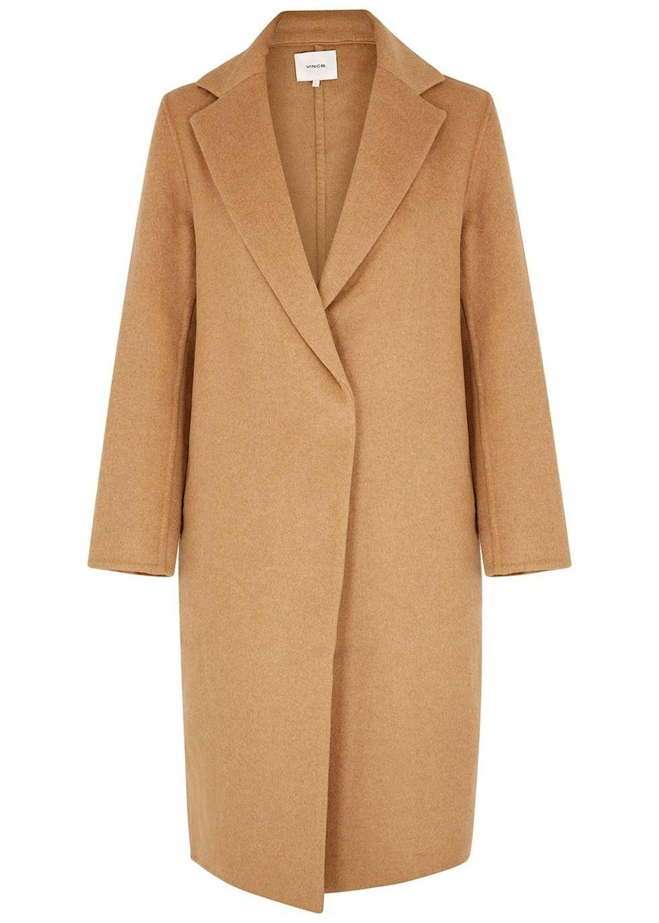 """<p><a class=""""link rapid-noclick-resp"""" href=""""https://www.harveynichols.com/brand/vince/457537-classic-camel-wool-blend-coat/p4126167/"""" rel=""""nofollow noopener"""" target=""""_blank"""" data-ylk=""""slk:SHOP NOW"""">SHOP NOW</a></p><p>Elegant as they are, long coats are undeniably impractical at times (especially since so many of us have swapped public transport for cycling these days). Vince has modernised the classic Chesterfield with an asymmetric fastening and minimal fastenings.</p><p>Classic Wool-blend Coat, £685, Vince</p>"""