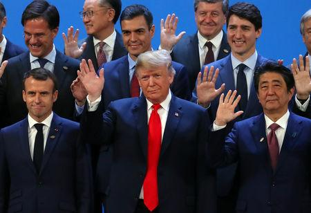 French President Emmanuel Macron, U.S. President Donald Trump, Japanese Prime Minister Shinzo Abe, Canada's Prime Minister Justin Trudeau and G20 leaders pose for a family photo during the G20 summit in Buenos Aires, Argentina November 30, 2018. REUTERS/Marcos Brindicci