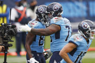 Tennessee Titans wide receiver Corey Davis (84) is congratulated by offensive guard Rodger Saffold (76) after Davis scored a touchdown against the Pittsburgh Steelers in the first half of an NFL football game Sunday, Oct. 25, 2020, in Nashville, Tenn. (AP Photo/Wade Payne)