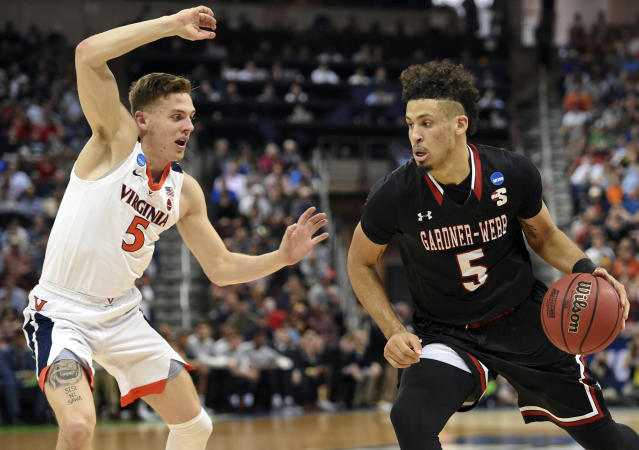 Gardner-Webb's Jose Perez (5) drives against Virginia's Kyle Guy during a first-round game in the NCAA mens college basketball tournament in Columbia, S.C., Friday, March 22, 2019. (AP Photo/Richard Shiro)