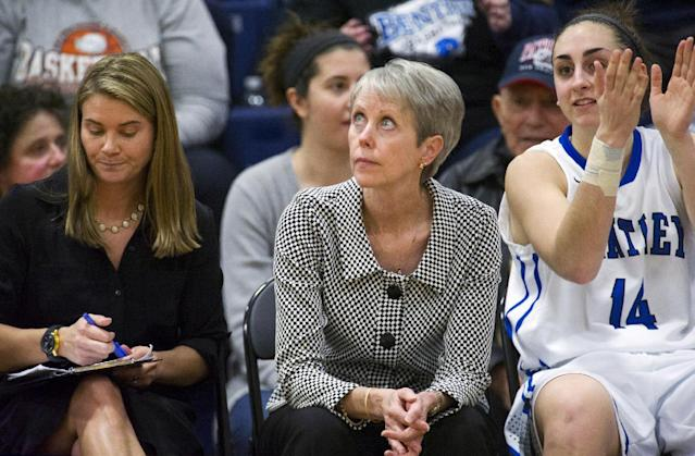 FILE - In this Jan. 25, 2014, file photo, Bentley women's basketball coach Barbara Stevens, center, looks up at the clock in the final seconds of her team's win over Saint Anselm in an NCAA Division II college basketball game in Waltham, Mass. Stevens is one of six women's basketball coaches with at least 900 wins. Now the undefeated Falcons chase a goal an NCAA Division II championship. (AP Photo/The Telegram & Gazette, Betty Jenewin, File)