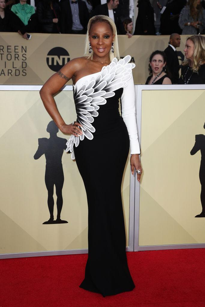 <p>Blige spoke about her gratitude toward the recognition of her growing acting career on the red carpet, while wearing a bold black-and-white dress. (Photo: Getty Images) </p>