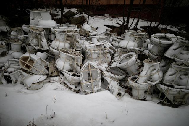 <p>Toilets are piled up at the abandoned Alps Ski Resort located near the demilitarized zone separating the two Koreas in Goseong, South Korea, Jan. 17, 2018. (Photo: Kim Hong-Ji/Reuters) </p>