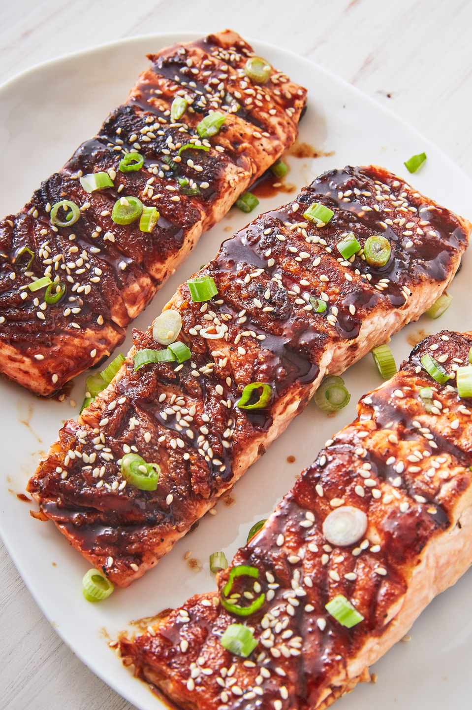"""<p>This spicy Asian glaze will make you forget all about regular BBQ sauce.</p><p>Get the recipe from <a href=""""https://www.delish.com/cooking/recipe-ideas/recipes/a53482/best-bbq-salmon-recipe/"""" rel=""""nofollow noopener"""" target=""""_blank"""" data-ylk=""""slk:Delish"""" class=""""link rapid-noclick-resp"""">Delish</a>.</p>"""