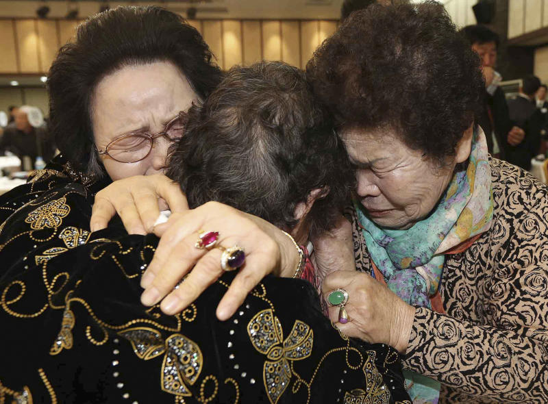 North Korean Kim Tae Un, center, his South Korean sister Kim Sa-bun and Kim Young-soon, right, get emotional as they reunite during the Separated Family Reunion Meeting at Diamond Mountain resort in North Korea, Sunday, Feb. 23, 2014. Elderly North and South Koreans separated for six decades are tearfully reuniting, grateful to embrace children, brothers, sisters and spouses they had thought they might never see again. (AP Photo/Yonhap, Lee Ji-eun) KOREA OUT