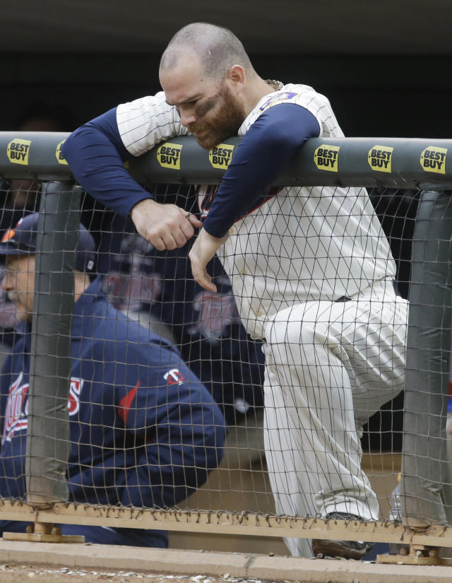 Minnesota Twins' Ryan Doumit rests his chin on the dugout rail in the ninth inning of a baseball game against the Cleveland Indians Saturday, Sept. 28, 2013, in Minneapolis. The Cleveland won 5-1. (AP Photo/Jim Mone)