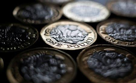 FILE PHOTO - Pound coins are seen in the photo illustration taken in Manchester, Britain September 6, 2017. REUTERS/Phil Noble/Illustration