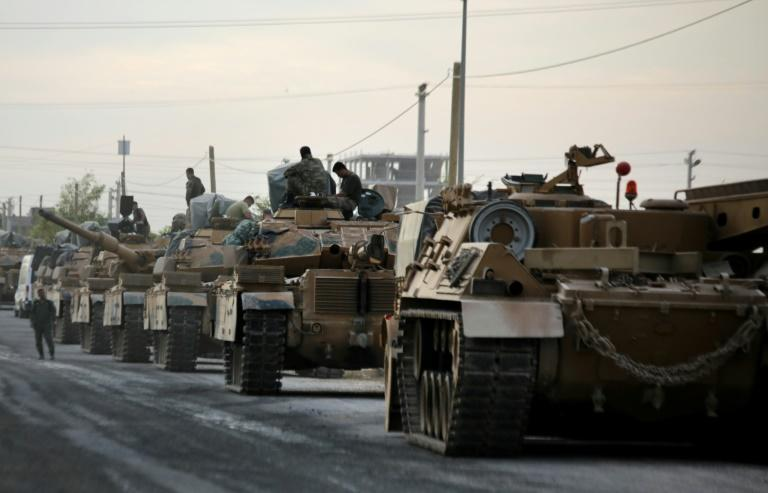 There has been a heavy military build-up around the Turkey-Syria border area (AFP Photo/Bakr ALKASEM)